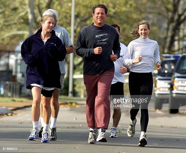Democratic presidential candidate and Vice President Al Gore jogs with his family including his daughters Kristin Karenna Gore Schiff and his...