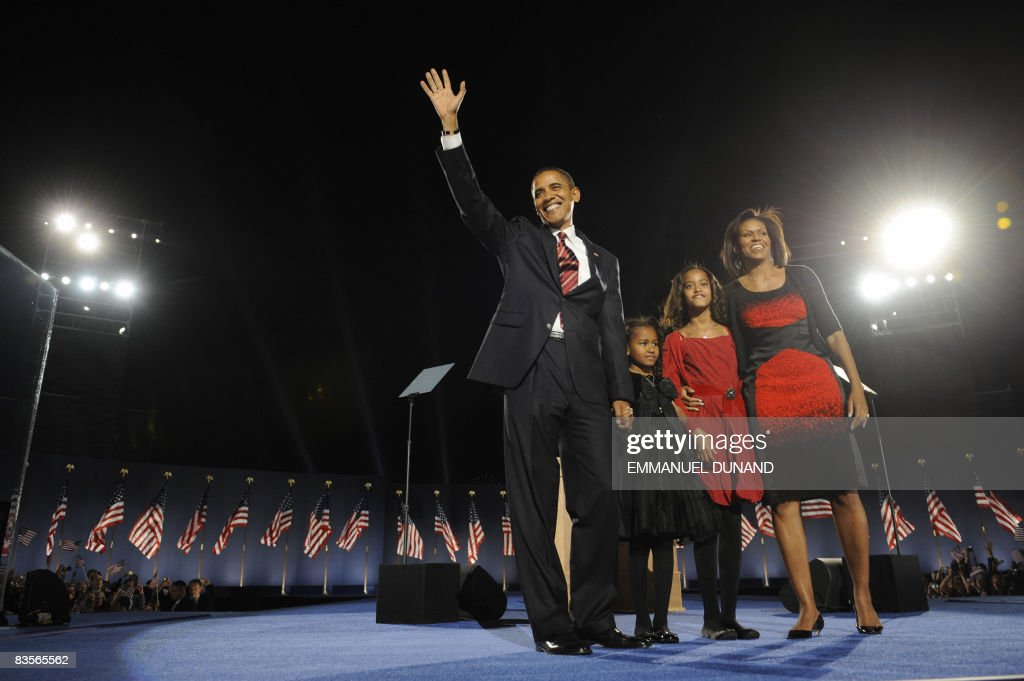 Democratic presidential candidate Barack Obama and his family arrive on stage for his election night victory rally at Grant Park on November 4, 2008 in Chicago, Illinois. Americans emphatically elected Obama as their first black president in a transformational election which will reshape US politics and the US role on the world stage. AFP PHOTO / Emmanuel DUNAND