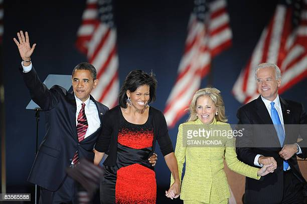 Democratic presidential candidate Barack Obama and his wife Michelle stand on stage with running mate Joe Biden and his wife Jill during their...