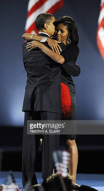 Democratic presidential candidate Barack Obama and his wife Michelle embrace on stage after Obama addressed his election night victory rally at Grant...