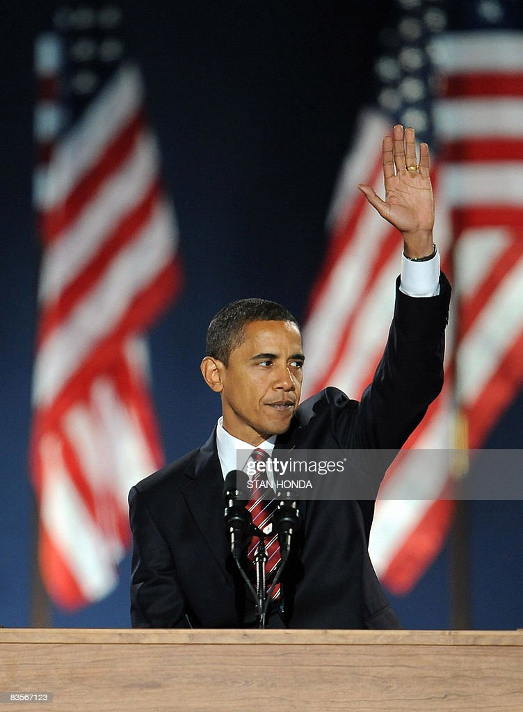 Democratic presidential candidate Barack Obama waves to supporters during his election night victory rally at Grant Park on November 4, 2008 in Chicago, Illinois. Americans emphatically elected Obama as their first black president in a transformational election which will reshape US politics and the US role on the world stage. AFP PHOTO / Stan HONDA