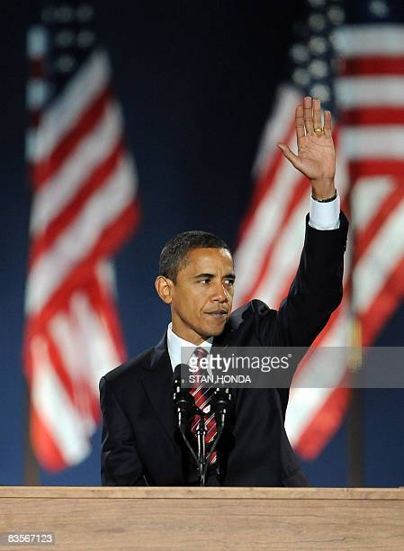 Democratic presidential candidate Barack Obama waves to supporters during his election night victory rally at Grant Park on November 4 2008 in...