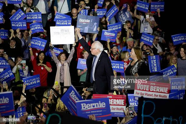 Democratic presidential candidate Bernie Sanders acknowledges the crowd before speaking during his Caucus night event at the at the Holiday Inn...
