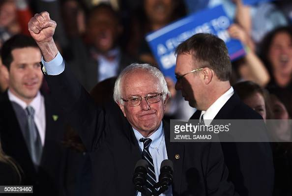 Democratic presidential candidate Bernie Sanders celebrates his victory during the primary night rally in Concord New Hampshire on February 9 2016...