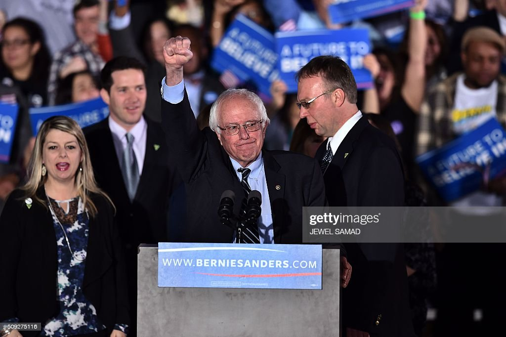 US Democratic presidential candidate Bernie Sanders celebrates victory during a primary night rally in Concord, New Hampshire, on February 9, 2016. Political novice Donald Trump and self-described democratic socialist Bernie Sanders won New Hampshire's presidential primaries Tuesday, US media projected, turning the American political establishment on its head early in the long nominations battle. / AFP / Jewel Samad