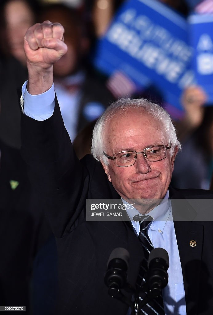 US Democratic presidential candidate Bernie Sanders gestures on stage during a primary night rally in Concord, New Hampshire, on February 9, 2016. Political novice Donald Trump and self-described democratic socialist Bernie Sanders won New Hampshire's presidential primaries Tuesday, US media projected, turning the American political establishment on its head early in the long nominations battle. / AFP / Jewel Samad