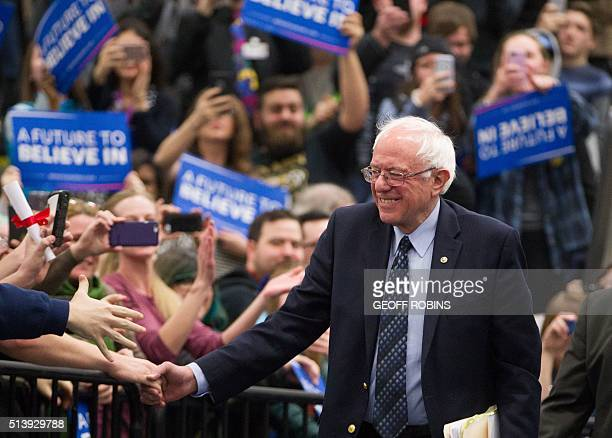 Democratic presidential candidate Bernie Sanders greets supporters at a rally at Macomb Community College in Warren Michigan March 5 2016 / AFP /...