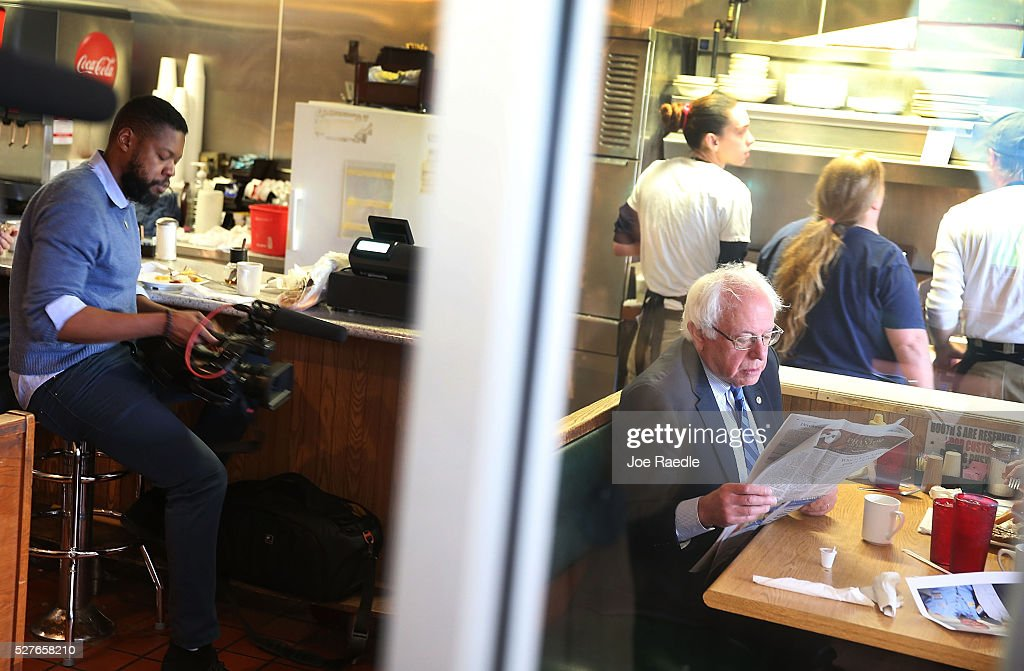 Democratic presidential candidate <a gi-track='captionPersonalityLinkClicked' href=/galleries/search?phrase=Bernie+Sanders&family=editorial&specificpeople=2908340 ng-click='$event.stopPropagation()'>Bernie Sanders</a> (D-VT) looks at a newspaper as he has breakfast at Peppy Grill on May 3, 2016 in Indianapolis, Indiana. Indiana voters went to the polls today as they decide who to cast their ballot for during the states primary election.