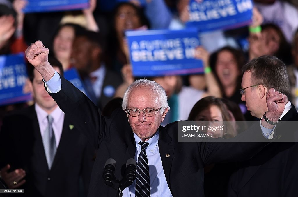 US Democratic presidential candidate Bernie Sanders reacts on stage during a primary night rally in Concord, New Hampshire, on February 9, 2016. Political novice Donald Trump and self-described democratic socialist Bernie Sanders won New Hampshire's presidential primaries Tuesday, US media projected, turning the American political establishment on its head early in the long nominations battle. / AFP / Jewel Samad