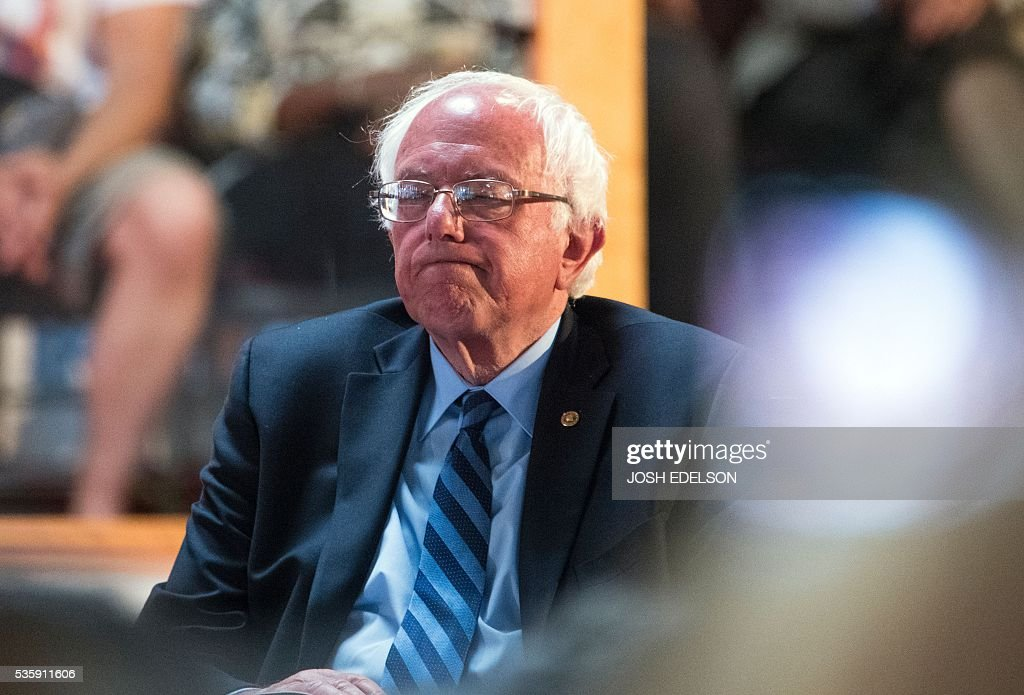 Democratic presidential candidate Bernie Sanders reacts while being introduced at the Allen Temple Baptist Church in Oakland, California on May 30, 2016. / AFP / JOSH