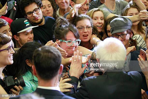 Democratic presidential candidate Bernie Sanders shakes hands after a speech at West High School at a campaign rally on March 21 2016 in Salt Lake...