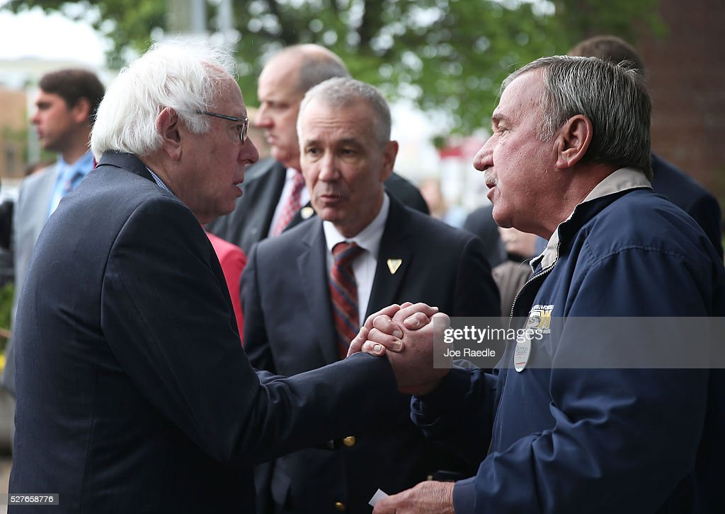 Democratic presidential candidate <a gi-track='captionPersonalityLinkClicked' href=/galleries/search?phrase=Bernie+Sanders&family=editorial&specificpeople=2908340 ng-click='$event.stopPropagation()'>Bernie Sanders</a> (D-VT) shakes hands with United Steelworkers President, Local 1999, Chuck Jones, after having breakfast at Peppy Grill on May 3, 2016 in Indianapolis, Indiana. Indiana voters went to the polls today as they decide who to cast their ballot for during the states primary election.
