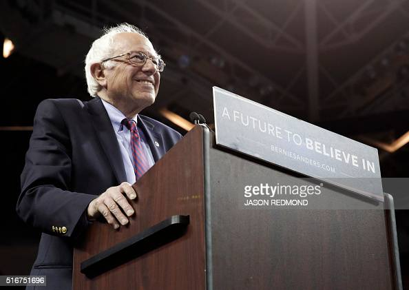 Democratic presidential candidate Bernie Sanders smiles as he arrives on stage for a rally at Key Arena on March 20 2016 in Seattle / AFP / Jason...