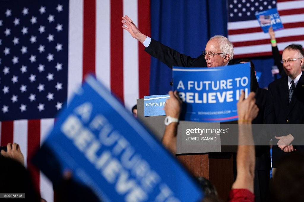 US Democratic presidential candidate Bernie Sanders speaks during the primary night rally in Concord, New Hampshire, on February 9, 2016. Self-described democratic socialist Bernie Sanders and political novice Donald Trump won New Hampshire's presidential primaries Tuesday, US media projected, turning the American political establishment on its head early in the long nominations battle. / AFP / JEWEL SAMAD