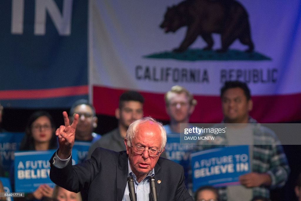 Democratic presidential candidate Bernie Sanders speaks near the California state flag during a campaign rallyduring a campaign rally at the Riverside Municipal Auditorium on May 24, 2016 in Riverside, California. US presidential candidates have turned their attention to campaigning in earnest for the June 7th California primary election. / AFP / DAVID