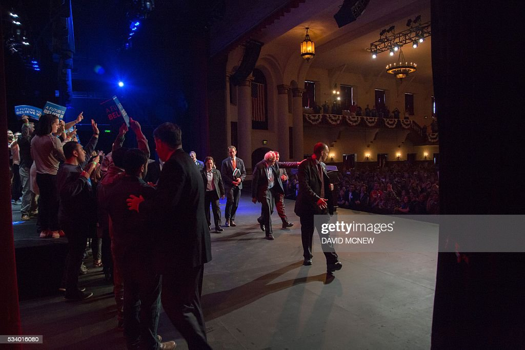 Democratic presidential candidate Bernie Sanders walks off stage after addressing a campaign rally at the Riverside Municipal Auditorium on May 24, 2016 in Riverside, California. US presidential candidates have turned their attention to campaigning in earnest for the June 7th California primary election. / AFP / DAVID