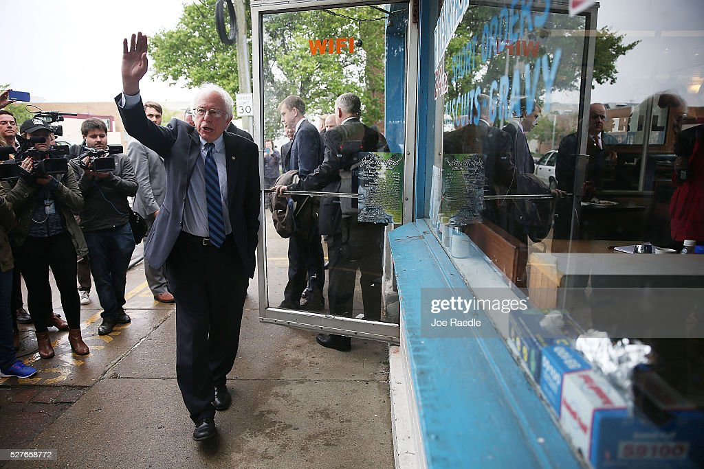 Democratic presidential candidate <a gi-track='captionPersonalityLinkClicked' href=/galleries/search?phrase=Bernie+Sanders&family=editorial&specificpeople=2908340 ng-click='$event.stopPropagation()'>Bernie Sanders</a> (D-VT) waves to supporters before speaking to the media after a stop for breakfast at Peppy Grill on May 3, 2016 in Indianapolis, Indiana. Indiana voters went to the polls today as they decide who to cast their ballot for during the states primary election.