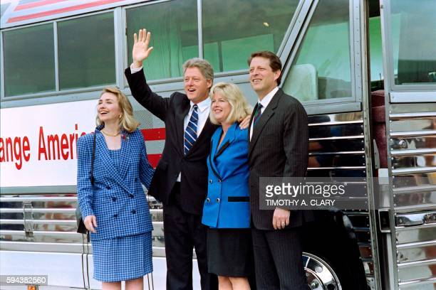 Democratic Presidential candidate Bill Clinton waves on August 5 1992 along his wife Hillary running mate Sen Al Gore and his wife Tipper before they...