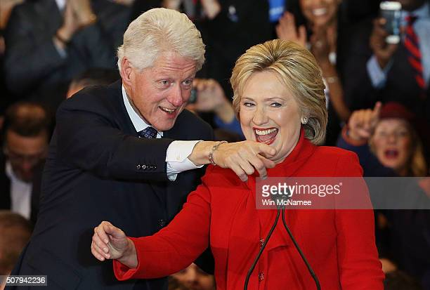 Democratic presidential candidate former Secretary of State Hillary Clinton and Former US president Bill Clinton take the stage during her caucus...