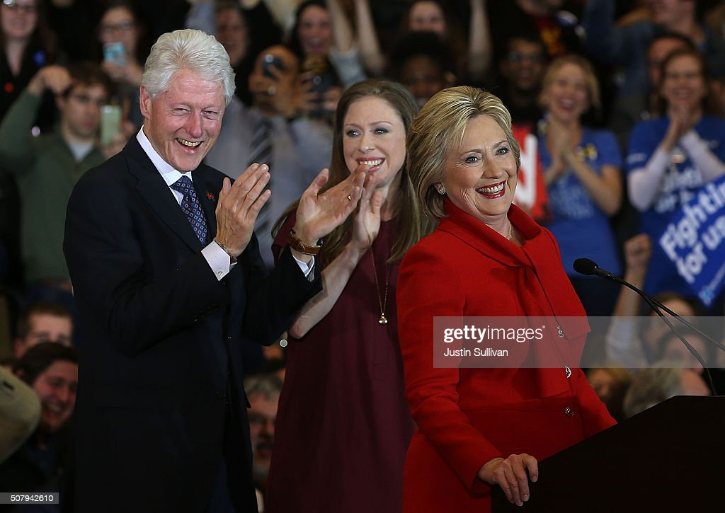 Democratic presidential candidate former Secretary of State Hillary Clinton speaks to supporters as Former US president Bill Clinton and daughter...