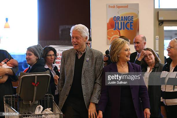 Democratic presidential candidate former Secretary of State Hillary Clinton and her husband former US president Bill Clinton greet customers at a...