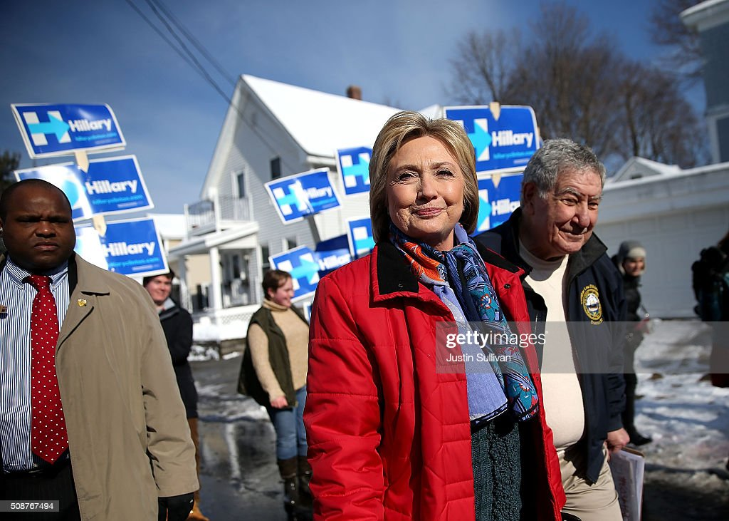 Democratic presidential candidate former Secretary of State <a gi-track='captionPersonalityLinkClicked' href=/galleries/search?phrase=Hillary+Clinton&family=editorial&specificpeople=76480 ng-click='$event.stopPropagation()'>Hillary Clinton</a> (L) walks with New Hampshire state senator Lou D'Allesandro as they knock on doors to greet voters on February 6, 2016 in Manchester, New Hampshire. With less than one week to go before the New Hampshire primaries, <a gi-track='captionPersonalityLinkClicked' href=/galleries/search?phrase=Hillary+Clinton&family=editorial&specificpeople=76480 ng-click='$event.stopPropagation()'>Hillary Clinton</a> continues to campaign throughout the state.