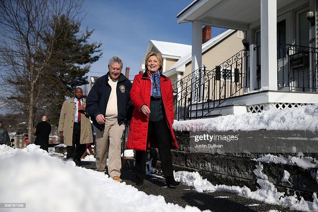 Democratic presidential candidate former Secretary of State <a gi-track='captionPersonalityLinkClicked' href=/galleries/search?phrase=Hillary+Clinton&family=editorial&specificpeople=76480 ng-click='$event.stopPropagation()'>Hillary Clinton</a> (R) walks with New Hampshire state senator Lou D'Allesandro as they knock on doors to greet voters on February 6, 2016 in Manchester, New Hampshire. With less than one week to go before the New Hampshire primaries, <a gi-track='captionPersonalityLinkClicked' href=/galleries/search?phrase=Hillary+Clinton&family=editorial&specificpeople=76480 ng-click='$event.stopPropagation()'>Hillary Clinton</a> continues to campaign throughout the state.