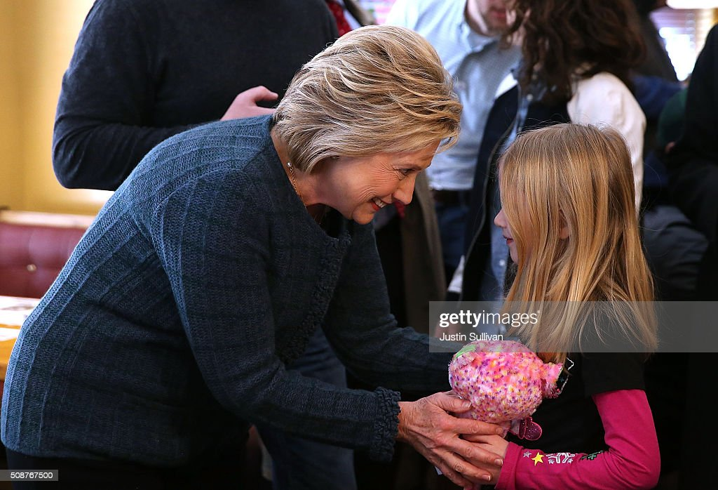 Democratic presidential candidate former Secretary of State <a gi-track='captionPersonalityLinkClicked' href=/galleries/search?phrase=Hillary+Clinton&family=editorial&specificpeople=76480 ng-click='$event.stopPropagation()'>Hillary Clinton</a> greets a young patron at Belmont Hall and Restaurant on February 6, 2016 in Manchester, New Hampshire. With less than one week to go before the New Hampshire primaries, <a gi-track='captionPersonalityLinkClicked' href=/galleries/search?phrase=Hillary+Clinton&family=editorial&specificpeople=76480 ng-click='$event.stopPropagation()'>Hillary Clinton</a> continues to campaign throughout the state.