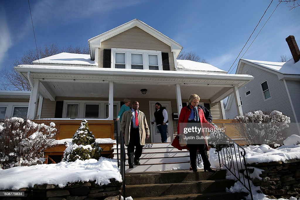 Democratic presidential candidate former Secretary of State Hillary Clinton leaves a home as she knocks on doors to greet voters on February 6, 2016 in Manchester, New Hampshire. With less than one week to go before the New Hampshire primaries, Hillary Clinton continues to campaign throughout the state.