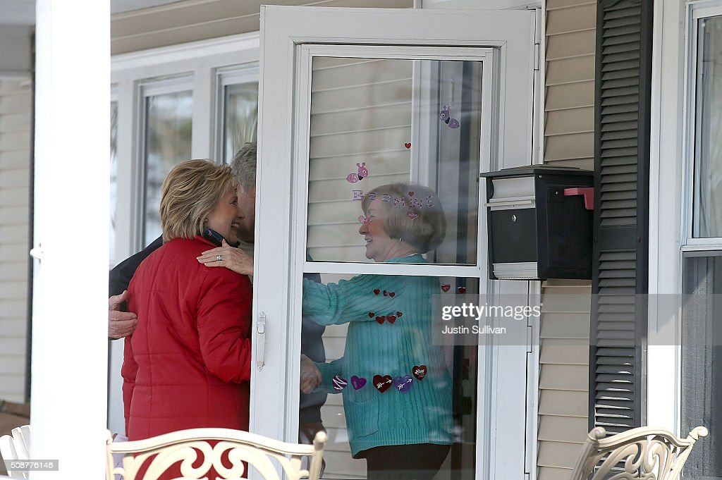 Democratic presidential candidate former Secretary of State Hillary Clinton greets a resident as she knocks on doors to greet voters on February 6, 2016 in Manchester, New Hampshire. With less than one week to go before the New Hampshire primaries, Hillary Clinton continues to campaign throughout the state.