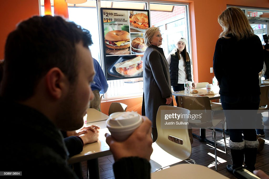 Democratic presidential candidate former Secretary of State Hillary Clinton greets patrons at a Dunkin Donuts on February 7, 2016 in Manchester, New Hampshire. With less than one week to go before the New Hampshire primaries, Hillary Clinton continues to campaign throughout the state.