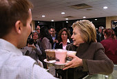 Democratic presidential candidate former Secretary of State Hillary Clinton picks up milkshakes at Puritan Ice Cream and Take Out on February 7 2016...