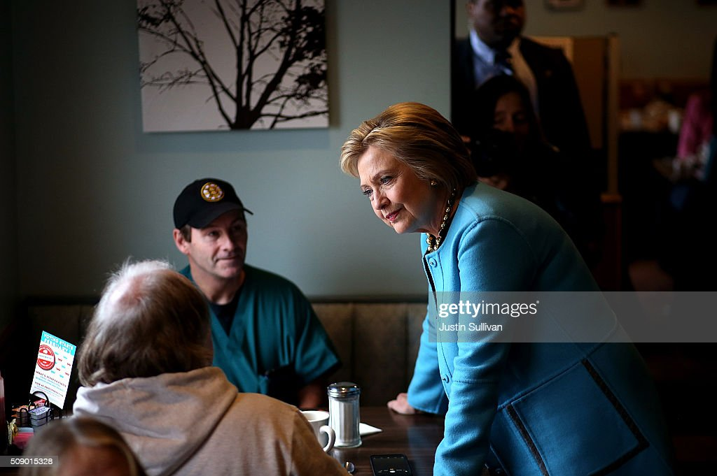 Democratic presidential candidate former Secretary of State Hillary Clinton greets patrons at Chez Vachon on February 8, 2016 in Manchester, New Hampshire. With one day to go before the New Hampshire primaries, Hillary Clinton continues to campaign throughout the state.