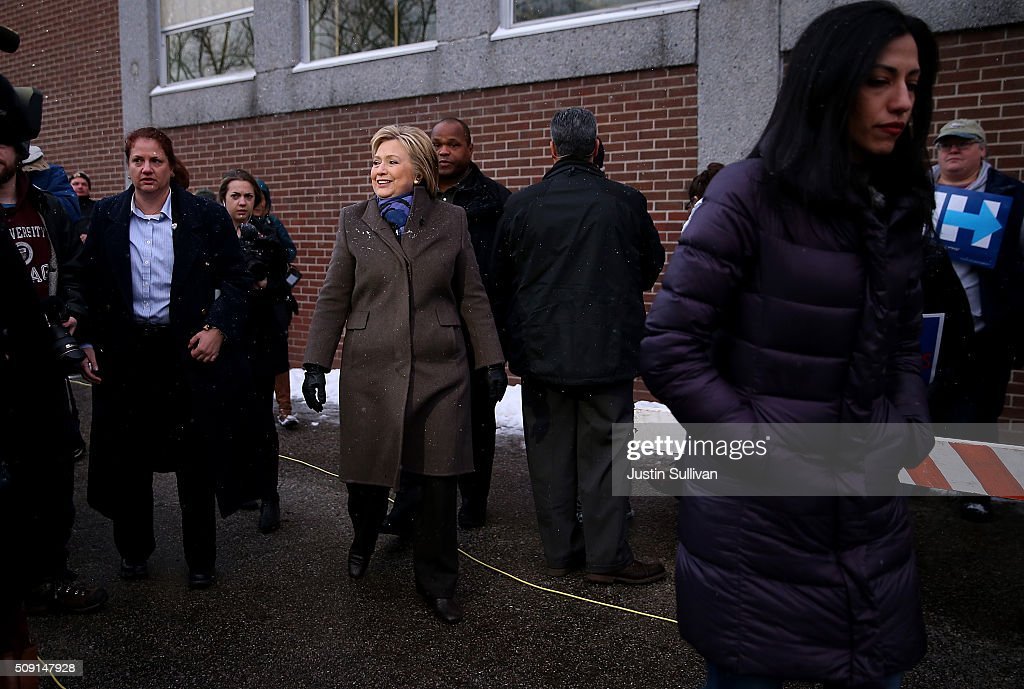 Democratic presidential candidate former Secretary of State Hillary Clinton greets voters outside of a polling station at Parker Varney School on February 9, 2016 in Manchester, New Hampshire. New Hampshire voters are heading to the polls in the nation's first primaries.