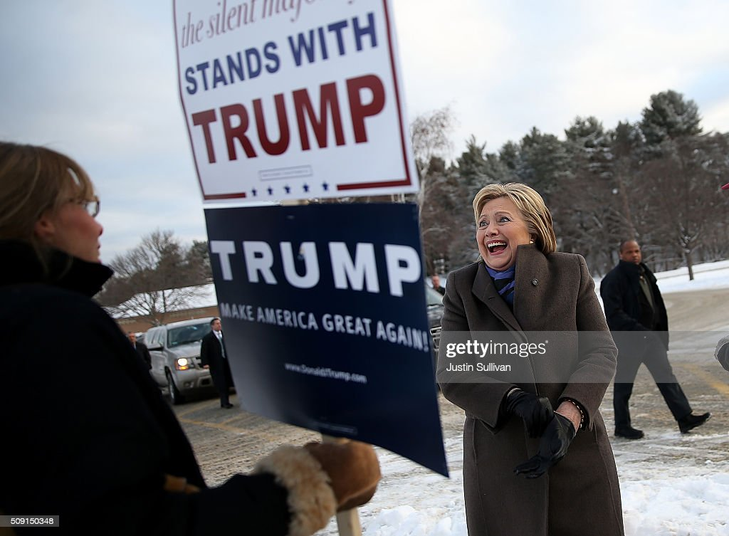 Democratic presidential candidate former Secretary of State Hillary Clinton greets voters outside of a polling station at Fairgrounds Junior High School on February 9, 2016 in Nashua, New Hampshire. New Hampshire voters are heading to the polls in the nation's first primaries.