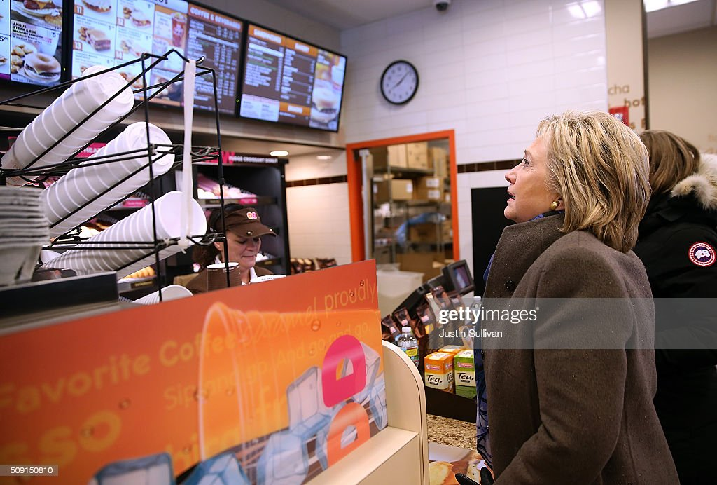 Democratic presidential candidate former Secretary of State <a gi-track='captionPersonalityLinkClicked' href=/galleries/search?phrase=Hillary+Clinton&family=editorial&specificpeople=76480 ng-click='$event.stopPropagation()'>Hillary Clinton</a> orders food at a Dunkin' Donuts on February 9, 2016 in Nashua, New Hampshire. New Hampshire voters are heading to the polls in the nation's first primaries.