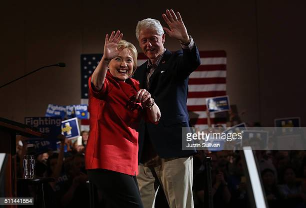Democratic presidential candidate former Secretary of State Hillary Clinton and her husband former President Bill Clinton greet supporters during a...