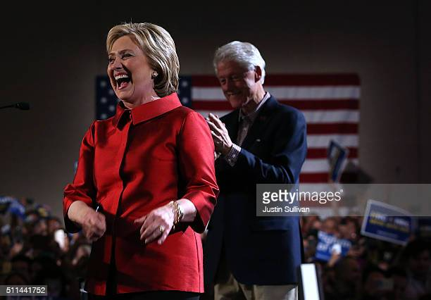 Democratic presidential candidate former Secretary of State Hillary Clinton greets supporters at a caucus day event as her husband former President...