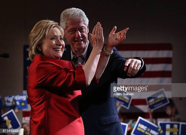 Democratic presidential candidate former Secretary of State Hillary Clinton and her husband former US president Bill Clinton greet supporters during...