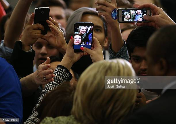 Democratic presidential candidate former Secretary of State Hillary Clinton takes selfies with supporters during a 'Get Out the Vote' event at the...