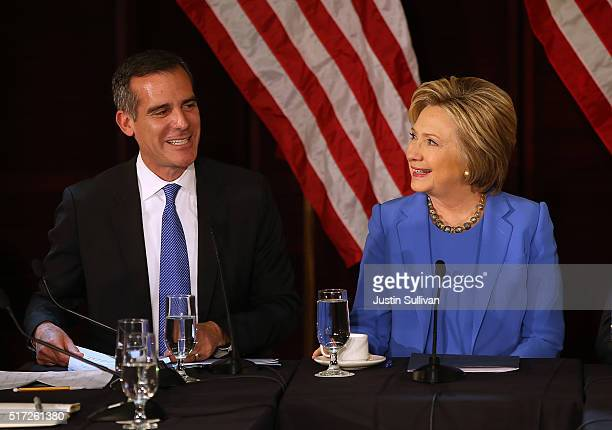 Democratic presidential candidate former Secretary of State Hillary Clinton talks with Los Angeles mayor Eric Garcetti during a roundtable discussion...