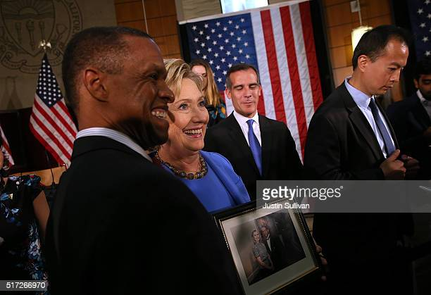 Democratic presidential candidate former Secretary of State Hillary Clinton greets attendees at the conclusion of a roundtable discussion at the...