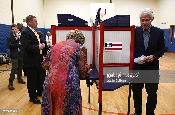 Democratic presidential candidate former Secretary of State Hillary Clinton and her husband former US president Bill Clinton vote at Douglas Grafflin...