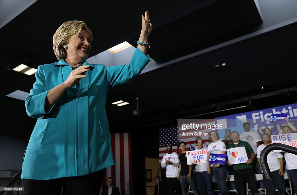 Democratic presidential candidate former Secretary of State <a gi-track='captionPersonalityLinkClicked' href=/galleries/search?phrase=Hillary+Clinton&family=editorial&specificpeople=76480 ng-click='$event.stopPropagation()'>Hillary Clinton</a> greets supporters during a campaign event on May 24, 2016 in Commerce, California. <a gi-track='captionPersonalityLinkClicked' href=/galleries/search?phrase=Hillary+Clinton&family=editorial&specificpeople=76480 ng-click='$event.stopPropagation()'>Hillary Clinton</a> is campaigning in California ahaed of the State's presidential primary on June 7th.