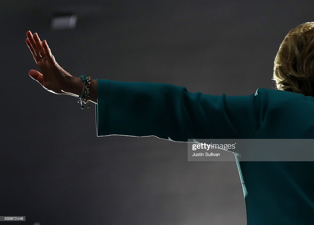 Democratic presidential candidate former Secretary of State <a gi-track='captionPersonalityLinkClicked' href=/galleries/search?phrase=Hillary+Clinton&family=editorial&specificpeople=76480 ng-click='$event.stopPropagation()'>Hillary Clinton</a> gestures as she speaks during a campaign event on May 24, 2016 in Commerce, California. <a gi-track='captionPersonalityLinkClicked' href=/galleries/search?phrase=Hillary+Clinton&family=editorial&specificpeople=76480 ng-click='$event.stopPropagation()'>Hillary Clinton</a> is campaigning in California ahaed of the State's presidential primary on June 7th.