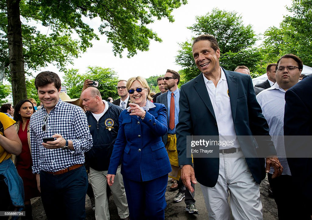 Democratic presidential candidate former Secretary of State Hillary Clinton and New York Governor Andrew M. Cuomo greet parade goers during the Memorial Day parade May 30, 2016 in Chappaqua, New York.
