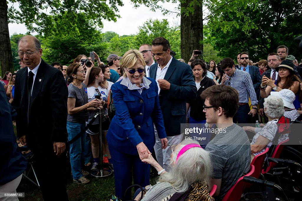 Democratic presidential candidate former Secretary of State Hillary Clinton greets parade goers after walking in the Memorial Day parade May 30, 2016 in Chappaqua, New York.