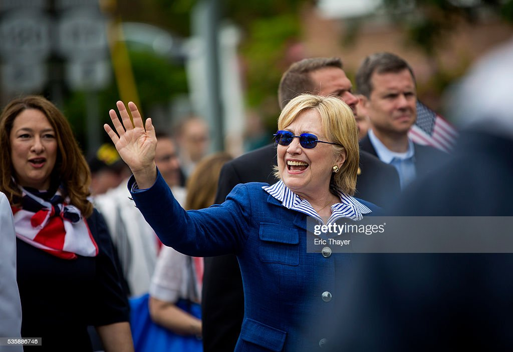 Democratic presidential candidate former Secretary of State <a gi-track='captionPersonalityLinkClicked' href=/galleries/search?phrase=Hillary+Clinton&family=editorial&specificpeople=76480 ng-click='$event.stopPropagation()'>Hillary Clinton</a> walks in the Memorial Day parade May 30, 2016 in Chappaqua, New York.