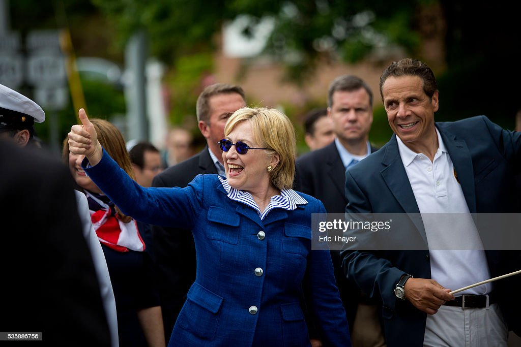 Democratic presidential candidate former Secretary of State <a gi-track='captionPersonalityLinkClicked' href=/galleries/search?phrase=Hillary+Clinton&family=editorial&specificpeople=76480 ng-click='$event.stopPropagation()'>Hillary Clinton</a> and New York Governor Andrew M. Cuomo walk in the Memorial Day parade May 30, 2016 in Chappaqua, New York.