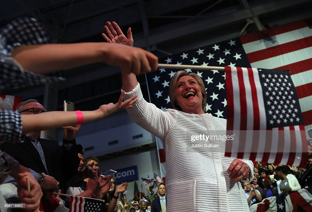 Democratic presidential candidate former Secretary of State Hillary Clinton greets supporters during a primary night event on June 7, 2016 in Brooklyn, New York. Hillary Clinton beat rival Bernie Sanders in the New Jersey presidential primary.